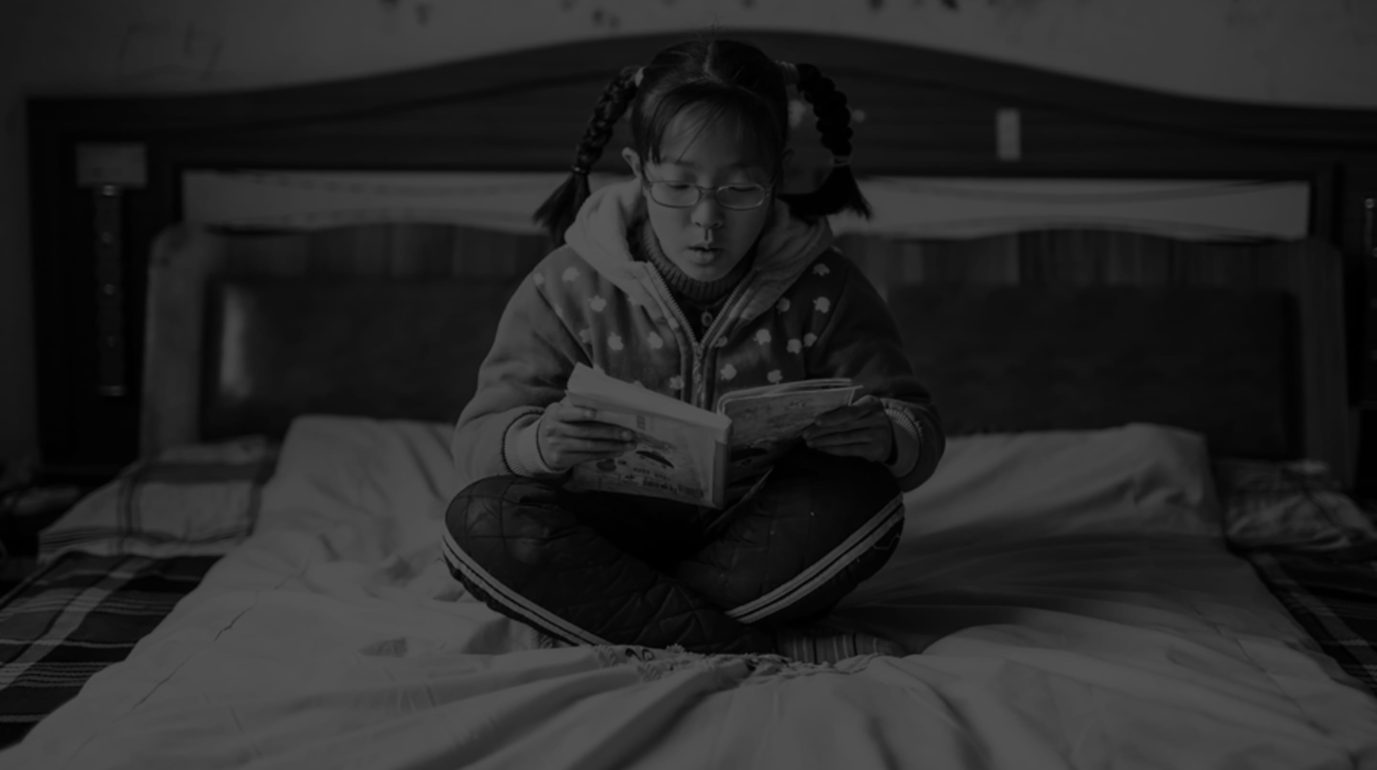 OneSight Beneficiary, Shiyu Zhai reading thanks to her charitable eyewear